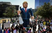 Members of the 'Full Rights for Immigrants Coalition' display a giant effigy of US Republican Party presidential hopeful Donald Trump during a protest on May Day in Los Angeles, California on 1 May, 2016. Picture: AFP.