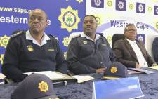 Western Cape Police Commissioner Lieutenant-General Khombinkosi Jula (left) at a briefing with Police Minister Fikile Mbalula (right) on 3 October in Philippi. Picture: Kevin Brandt/EWN