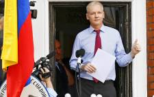 A file picture dated 19 August 2012 of Wikileaks founder Julian Assange on the balcony inside the Ecuador Embassy where he has sought political asylum in London. Picture: EPA/Kerim Okten.