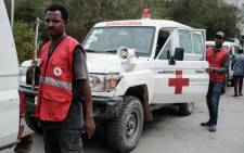 Red Cross ambulances are seen waiting on stand-by for authorisation to travel to Togoga, a village about 20km west of Mekele, where an alleged airstrike hit a market leaving an unknown number of casualties. Red Cross ambulances are standing by after being denied access to the site, at the Ayder referral hospital in Mekele, the capital of Tigray region, Ethiopia, on 23 June 2021. Picture: Yasuyoshi Chiba/AFP