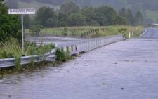 A file picture showing a flooded road on the outskirts of Lismore, in the north-east of Australia's NSW state. Picture: AFP.
