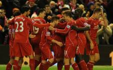 FILE: Liverpool players celebrate. Picture: AFP.
