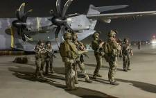 French soldiers stand guard near a military plane at airport in Kabul on August 17, 2021, as they arrive to evacuate French and Afghan nationals after the Taliban's stunning military takeover of Afghanistan. Picture: AFP