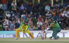 South Africa's Janneman Malan (R) watches the ball after playing a shot as Australia's Alex Carey (L) looks on during the second one-day international (ODI) cricket match at the Mangaung Oval in Bloemfontein on 4 March 2020. Picture: AFP