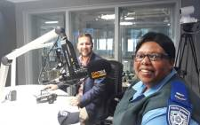 ‎General manager at Southern Sun Hotels Gary Reed pictured with traffic officer Amanda Fojo in the CapeTalk studios on 17 November 2017. Picture: CapeTalk.