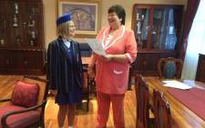 The 2014 Gauteng's top matriculant Sigourney Lishman's receiving her certificate. Picture: Barry Bateman/EWN.