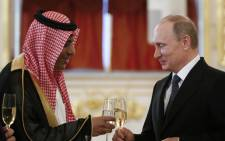 Russia's President Vladimir Putin toasts with Saudi Arabia's Ambassador Abdulrahman Al-Rassi after receiving a diplomatic credential from him during a ceremony at the Kremlin in Moscow on 28 May, 2015. Picture: AFP.
