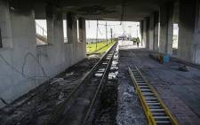 Work has begun on repairing the damage to the station platform where a train was petrol bombed at Chris Hani Station in Khayelitsha, 20 August 2014