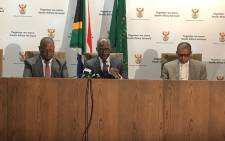 Home Affairs Minister Malusi Gigaba (centre) at a briefing on 25 September 2018. Picture: @HomeAffairsSA/Twitter