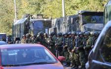 Special forces servicemen patrol a site at a college in the city of Kerch on 17 October 2018. At least 18 people died during an attack in a technical college on the Crimean Peninsula. Picture: AFP.