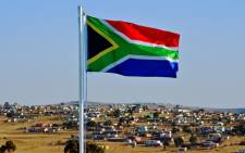 The South African flag flies near Qunu. Picture: AFP.