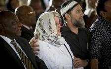 FILE: Ahmed Kathrada's life partner Barbara Hogan is comforted during the anti-apartheid activist's official state funeral at Westpark cemetery in Johannesburg on 29 March 2017. Picture: Reinart Toerien/EWN.