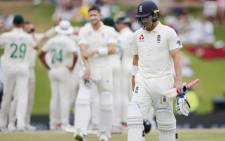 England's Rory Burns (R) walks back to the pavilion after his dismissal by South Africa's Anrich Nortje during the fourth day of the first Test cricket match between South Africa and England at The SuperSport Park stadium at Centurion near Pretoria on 29 December 2019. Picture: AFP.