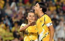 Australia's Samantha Kerr (R) shouts after scoring a penalty kick during the women's Olympic football tournament qualifier match between Australia and Vietnam in Newcastle on 6 March 2020. Picture: AFP