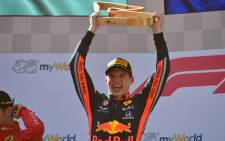 Red Bull Racing's Dutch driver Max Verstappen celebrates on the podium after the Austrian Formula One Grand Prix in Spielberg on 30 June 2019. Picture: AFP