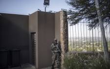 A guard of private security company Cortac stands guard at the start of his night shift in a gated community in Johannesburg, in February 2021. Picture: Michele Spatari/AFP