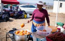 A picture of a hawker preparing food she is about to sell at the KZN elective conference in Ulundi on Saturday, 24 August 2019. Picture: Xanderleigh Dookey/EWN