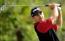This handout photo released and taken by OneAsia on 10 October, 2012 shows Louis Oosthuizen of South Africa hitting a shot during a Pro Am event ahead of the Nanshan China Masters at the Nanshan International Golf Club. Picture: AFP