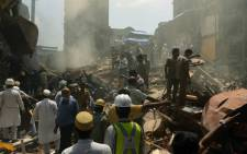 Rescue workers and residents look for survivors at the site of a building collapse in Mumbai on 31 August 2017.Picture: AFP