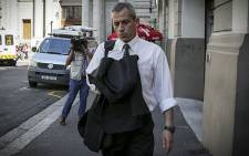 Ballistics expert Pieter Engelbrecht makes his way from the Western Cape High Court after testifying in the Honeymoon Trial.