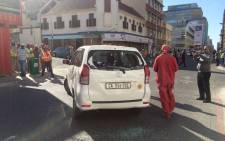 FILE: A damaged vehicle is seen during a protest by metered taxi drivers against Uber in the Cape Town CBD. Picture: Supplied.
