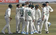 South Africa's Keshav Maharaj (2L) celebrates with teammates after taking the wicket of Pakistn's Azhar Ali (not pictured) during the first day of the second Test cricket match of a two-match series between Pakistan and South Africa at the Rawalpindi Cricket Stadium in Rawalpindi on 4 February 2021. Picture: Aamir Qureshi/AFP