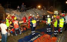 Rescue teams comb the scene for people who may be trapped under the rubble. Picture: AFP.
