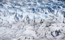 A picture taken on 6 November 2015 shows two soldiers checking a section of the Grey glacier in Torres del Paine National Park, south of Chile. Chilean scientists and members of the countrys armed forces have trained during seven days under extreme conditions in the Grey Glacier before setting out for an expedition to the middle of the ice sheet Antarctica. Picture: EPA/Felipe Trueba.