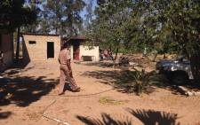A Correctional Service official walking through a school yard during a clean up operation in Vuwani. Picture: Thando Kubheka/EWN