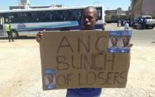 A DA supporter getting ready for the DA jobs march in the Johannesburg CBD on 12 February 2014. Picture: Reinart Toerien/EWN.