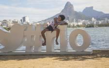 A young girl poses for a photo on a structure erected by the Lagoa Rodrigo de Freitas in Rio de Janeiro for the 2016 Olympics. Picture: Reinart Toerien/EWN.