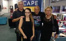 Amber Grey (front) stands with Cape Talk's Kieno Kammies (centre) and her parents Zain and Lizanne. Picture: Abed Ahmed/EWN.