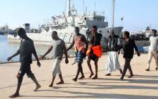 African migrants, who according to the Libyan navy were rescued by the country's coast guard, arrive at the naval base of the capital Tripoli on June 21, 2018. Picture: AFP.