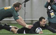 New Zealand's Israel Dagg dives a try followed by SA's Andries Bekker during the Tri-Nations rugby Test at Westpac Stadium on July 17, 2010. Picture: AFP.