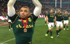 Bryan Habana celebrates with the crowd after the Springboks' record winning performance against Argentina in Johannesburg.