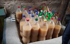 FILE: Illicit home-brewed alcohol confiscated by police. Picture: @SAPoliceService/Twitter