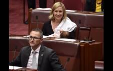 Australian senator Larissa Waters breastfeeding her daughter in Parliament. picture: @larissawaters.