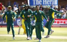 Proteas spinner Tabraiz Shamsi (front) celebrates taking a wicket. Picture: AFP