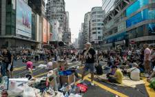 Pro-democracy demonstrators rest during a protest in Hong Kong on 30 September, 2014. Tens of thousands of pro-democracy protesters turned parts of Hong Kong into a massive street party. Picture: AFP.