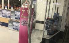 A section of the glass door at Game in Canal Walk was smashed as shoppers entered the store on Black Friday, 24 November 2017. Picture: Lauren Isaacs/EWN.