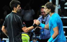 Novak Djokovic shakes hands with Rafael Nadal after beating him in the singles final of the ATP World Tour Finals in London on 11 November, 2013. Picture:AFP