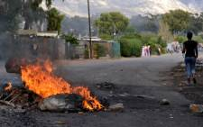 FILE: The scene from previous protests in Sir Lowry's Pass where residents demonstrated against housing issues and service delivery. Picture: EWN