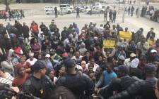 Police monitoring a group of protesters from Vrygrond outside the Civic Centre in Cape Town. Picture: Cindy Archillies/EWN.