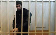 Zaur Dadayev, charged with the murder of Russian opposition figure Boris Nemtsov, stands inside a defendants' cage at the Basmanny district court in Moscow, on 8 March, 2015. Picture: AFP.