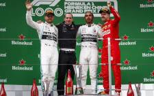 Mercedes' Valtteri Bottas (left), Lewis Hamilton (centre) and Ferrari's Sebastian Vettel on the podium after the Chinese Grand Prix in Shanghai on 14 April 2019. Picture: @MercedesAMGF1/Twitter