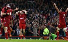 Wales players celebrate at the final whistle in the Autumn International rugby union Test match between Wales and South Africa at the Millennium Stadium in Cardiff, south Wales, on 29 November, 2014. Wales won the game 12-6. Picture: AFP.