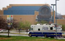 A police vehicle sits in front of the Jewish Community Center after three were killed when a gunman opened fire on 13 April, 2014 in Overland Park, Kansas. Picture: AFP.