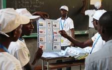 FILE: Members of Burundis Independent National Electoral Commission count votes at a polling station at the University of Burundi in Bujumbura on 21 July, 2015. Picture: AFP.
