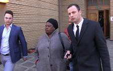 Oscar Pistorius leaves court with his brother Carl after the athlete's defence team wrapped up its case on 8 July 2014. Picture: Reinart Toerien/EWN.