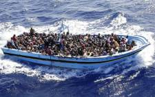 FILE: More than 900 illegal migrants are shipped to the mainland after being rescued by Italian Navy boat 'Fregata Euro' in the Mediterranean Sea, 12 September 2014. Picture: EPA.